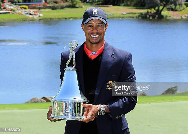 Tiger Woods of the United States proudly holds the trophy the win meant he re-gained the World's number one position after the final round of the...