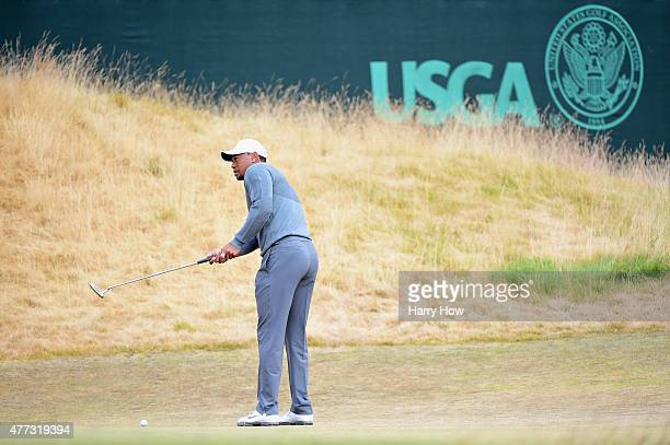 Tiger Woods of the United States putts on a green during a practice round prior to the start of the 115th U.S. Open Championship at Chambers Bay on...