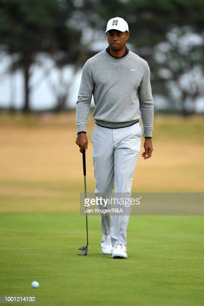Tiger Woods of the United States putts on the 11th green as he practices during previews to the 147th Open Championship at Carnoustie Golf Club on...