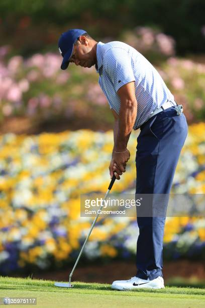 Tiger Woods of the United States putts on the 13th green during the second round of The PLAYERS Championship on The Stadium Course at TPC Sawgrass on...
