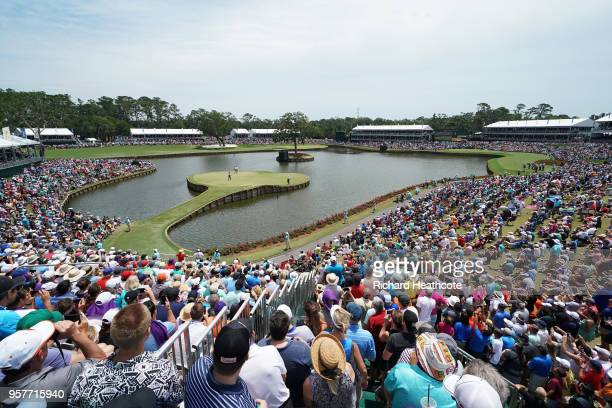 Tiger Woods of the United States putts on the 17th green during the third round of THE PLAYERS Championship on the Stadium Course at TPC Sawgrass on...