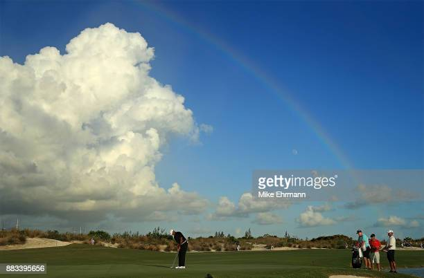 Tiger Woods of the United States putts on the 18th green during the first round of the Hero World Challenge at Albany, Bahamas on November 30, 2017...