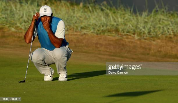 Tiger Woods of the United States putts on the 18th hole during the first round of the 147th Open Championship at Carnoustie Golf Club on July 19 2018...