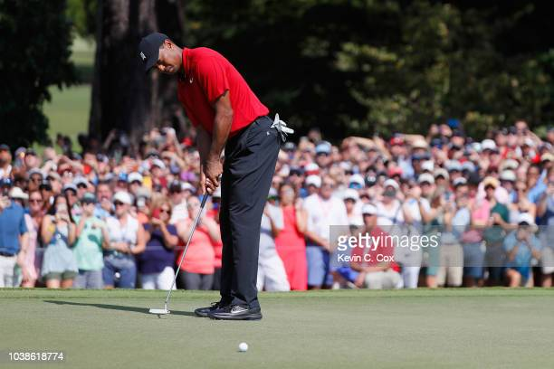 Tiger Woods of the United States putts on the fifth green during the final round of the TOUR Championship at East Lake Golf Club on September 23 2018...