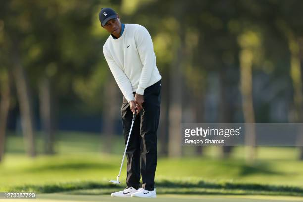 Tiger Woods of the United States putts on the fifth green during the second round of the 120th U.S. Open Championship on September 18, 2020 at Winged...