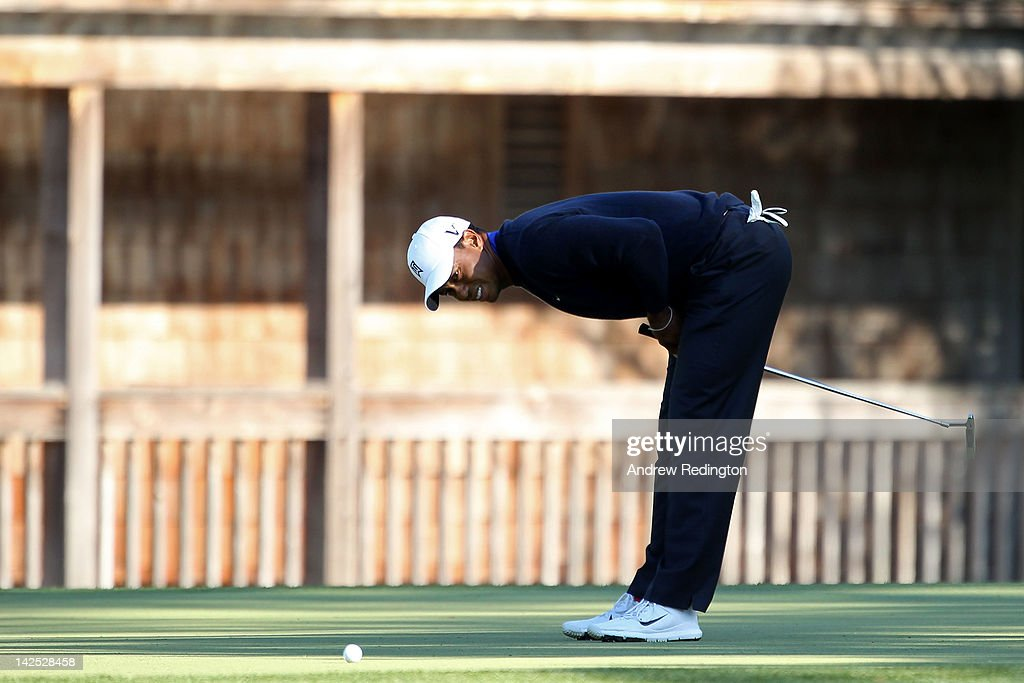 Tiger Woods of the United States reacts after a putt on the 11th green during the second round of the 2012 Masters Tournament at Augusta National Golf Club on April 6, 2012 in Augusta, Georgia.