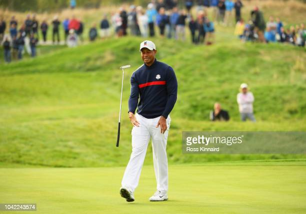 Tiger Woods of the United States reacts after a putt on the 5th green during the morning fourball matches of the 2018 Ryder Cup at Le Golf National...