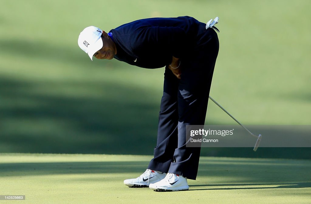 Tiger Woods of the United States reacts after a putt on the tenth green during the second round of the 2012 Masters Tournament at Augusta National Golf Club on April 6, 2012 in Augusta, Georgia.