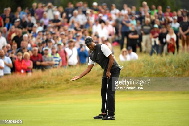Tiger Woods of the United States reacts after an eagle putt on the 14th green during round three of the Open Championship at Carnoustie Golf Club on...