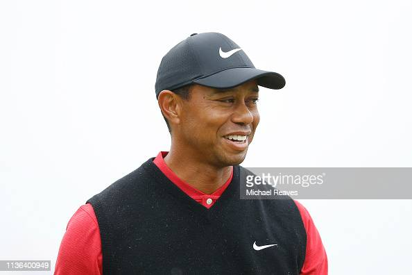 Tiger Woods of the United States reacts after chipping in ...