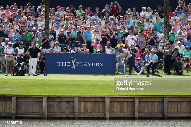 Tiger Woods of the United States reacts after hitting his shot into the water on the 17th tee during the second round of The PLAYERS Championship on...
