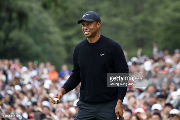 Tiger Woods of the United States reacts after holing out on the 9th green the first round of the ZOZO Championship at Accordia Golf Narashino Country...