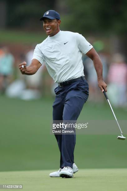 Tiger Woods of the United States reacts after making a birdie putt on the 15th green during the second round of the Masters at Augusta National Golf...