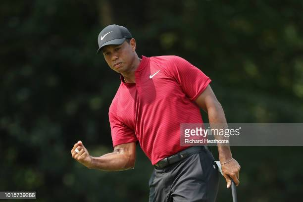 Tiger Woods of the United States reacts after making a putt for birdie on the ninth green during the final round of the 2018 PGA Championship at...