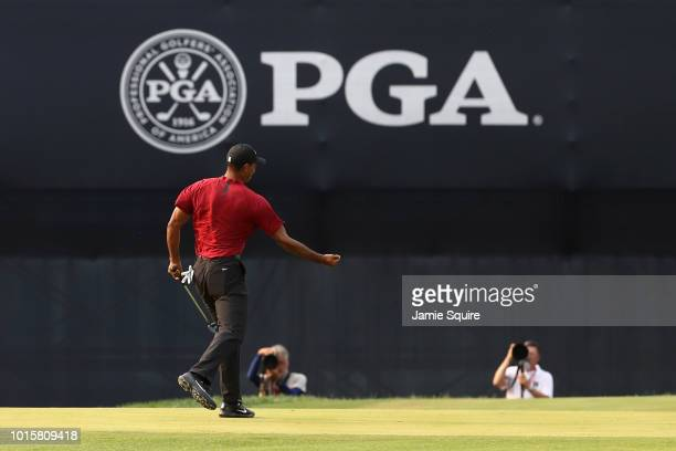 Tiger Woods of the United States reacts after making a putt for birdie on the 18th green during the final round of the 2018 PGA Championship at...