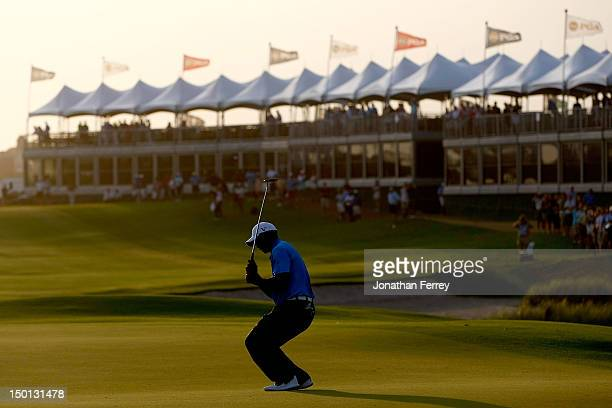 Tiger Woods of the United States reacts after missing a putt on the 18th green during Round Two of the 94th PGA Championship at the Ocean Course on...