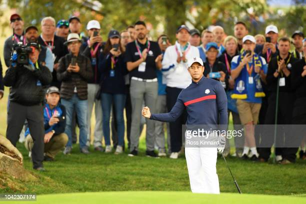 Tiger Woods of the United States reacts during the morning fourball matches of the 2018 Ryder Cup at Le Golf National on September 28 2018 in Paris...