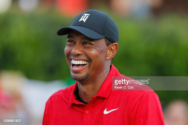 Tiger Woods of the United States reacts during the trophy presentation ceremony after winning the TOUR Championship at East Lake Golf Club on...