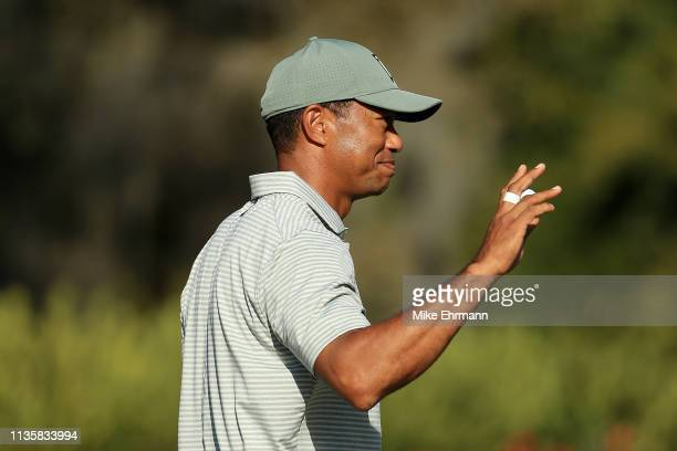 Tiger Woods of the United States reacts on the 13th green during the first round of The PLAYERS Championship on The Stadium Course at TPC Sawgrass on...