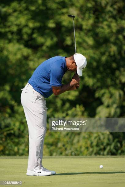 Tiger Woods of the United States reacts on the 14th green during the third round of the 2018 PGA Championship at Bellerive Country Club on August 11...