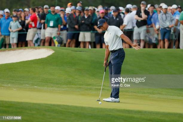 Tiger Woods of the United States reacts on the 17th green during the second round of the Masters at Augusta National Golf Club on April 12 2019 in...