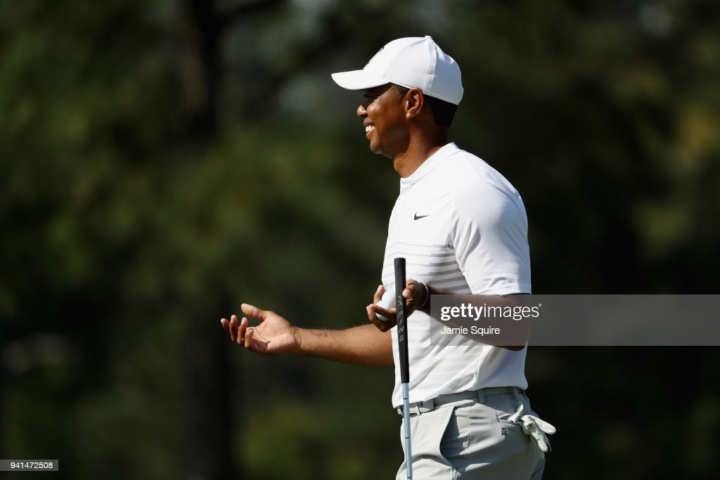 Tiger Woods of the United States reacts on the 17th hole during a practice round prior to the start of the 2018 Masters Tournament at Augusta National Golf Club on April 3, 2018 in Augusta, Georgia.