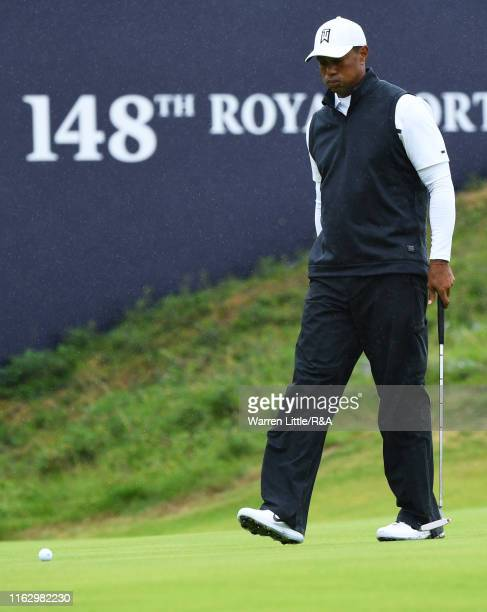 Tiger Woods of the United States reacts on the 18th green after completing the second round of the 148th Open Championship held on the Dunluce Links...
