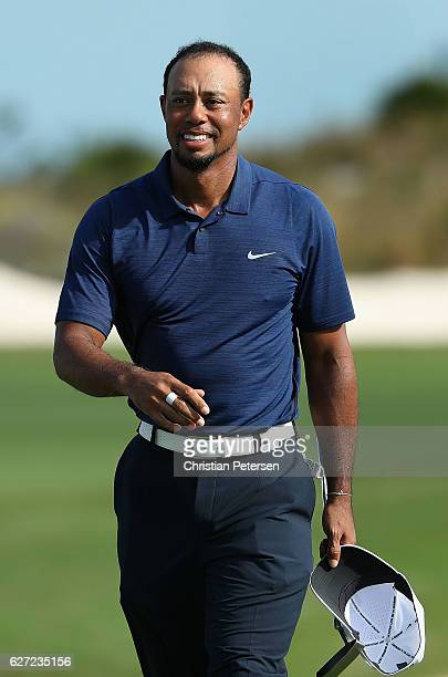 Tiger Woods of the United States reacts on the 18th green following the completion of round two of the Hero World Challenge at Albany The Bahamas on...