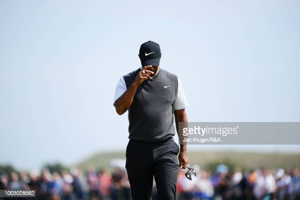 Tiger Woods of the United States reacts on the 6th hole green during round three of the Open Championship at Carnoustie Golf Club on July 21 2018 in...