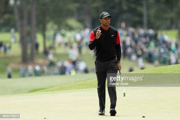 Tiger Woods of the United States reacts on the eighth green during the final round of the 2018 Masters Tournament at Augusta National Golf Club on...