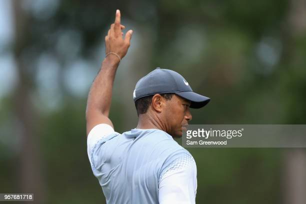 Tiger Woods of the United States reacts on the eighth green during the third round of THE PLAYERS Championship on the Stadium Course at TPC Sawgrass...