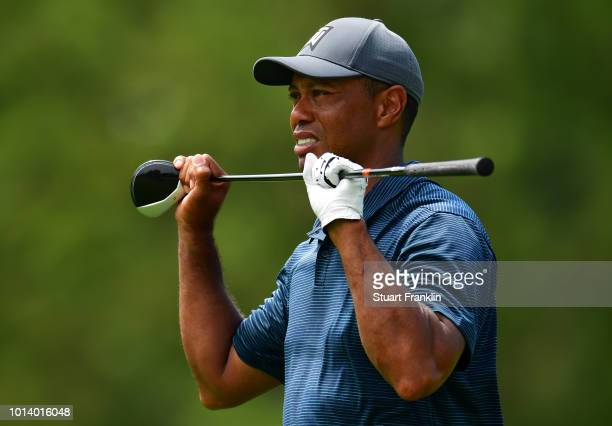 Tiger Woods of the United States reacts on the eighth hole during the first round of the 2018 PGA Championship at Bellerive Country Club on August 9...
