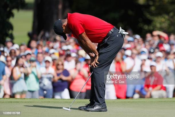 Tiger Woods of the United States reacts on the fifth green during the final round of the TOUR Championship at East Lake Golf Club on September 23...