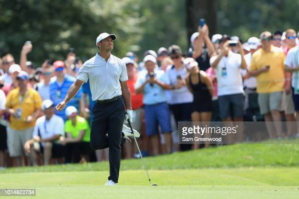 Tiger Woods of the United States reacts on the first hole during the second round of the 2018 PGA Championship at Bellerive Country Club on August 10...