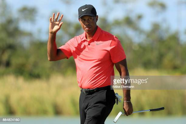 Tiger Woods of the United States reacts on the fourth green during the final round of the Hero World Challenge at Albany Bahamas on December 3 2017...