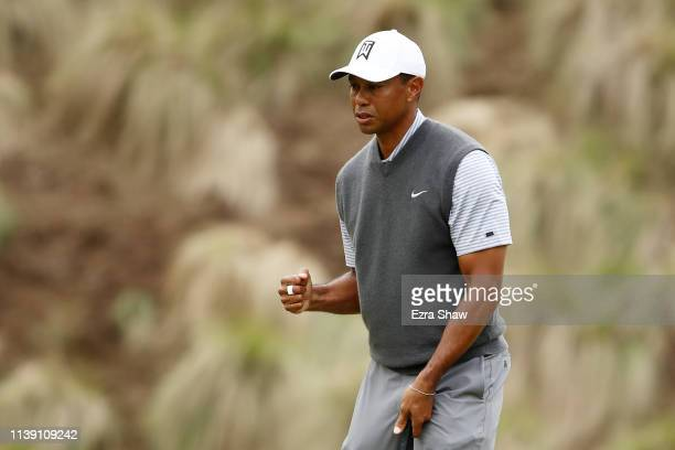 Tiger Woods of the United States reacts on the fourth green in his match against Patrick Cantlay of the United States during the third round of the...