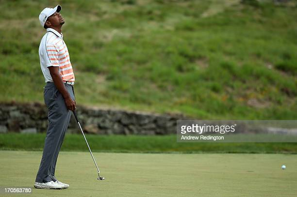 Tiger Woods of the United States reacts on the ninth green during Round Two of the 113th U.S. Open at Merion Golf Club on June 14, 2013 in Ardmore,...