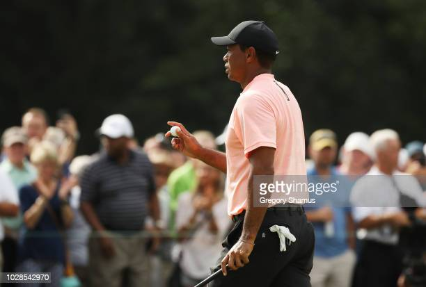 Tiger Woods of the United States reacts on the ninth green during the second round of the BMW Championship at Aronimink Golf Club on September 7,...