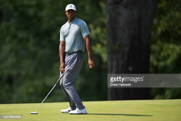 Tiger Woods of the United States reacts on the second green during the first round of the BMW Championship at Aronimink Golf Club on September 6,...