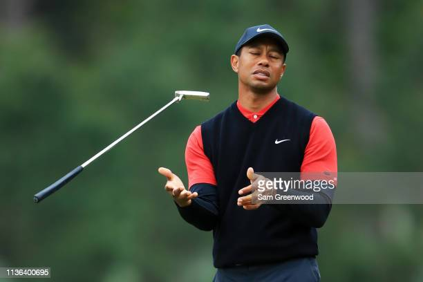 Tiger Woods of the United States reacts on the tenth green during the final round of The PLAYERS Championship on The Stadium Course at TPC Sawgrass...