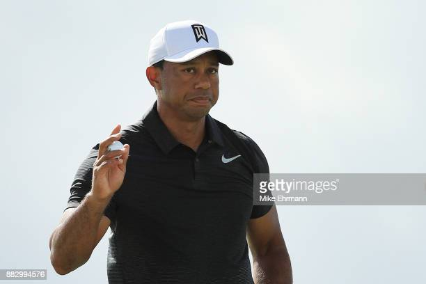 Tiger Woods of the United States reacts on the third green during the first round of the Hero World Challenge at Albany Bahamas on November 30 2017...