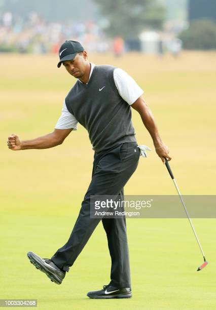 Tiger Woods of the United States reacts to a birdie on the ninth green during the third round of the 147th Open Championship at Carnoustie Golf Club...