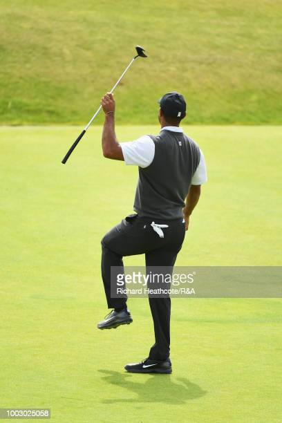 Tiger Woods of the United States reacts to a missed birdie putt on the 3rd hole green during round three of the Open Championship at Carnoustie Golf...