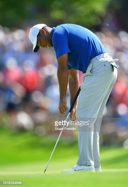 Tiger Woods of the United States reacts to a missed putt on the 11th green during the third round of the 2018 PGA Championship at Bellerive Country...