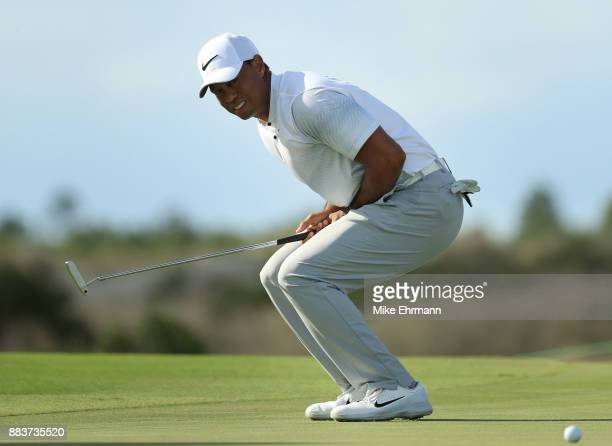 Tiger Woods of the United States reacts to a missed putt on the 12th green during the second round of the Hero World Challenge at Albany Bahamas on...