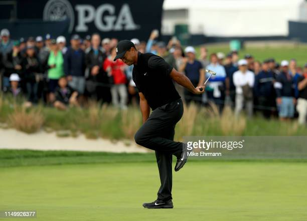 Tiger Woods of the United States reacts to a missed putt on the 17th green during the second round of the 2019 PGA Championship at the Bethpage Black...
