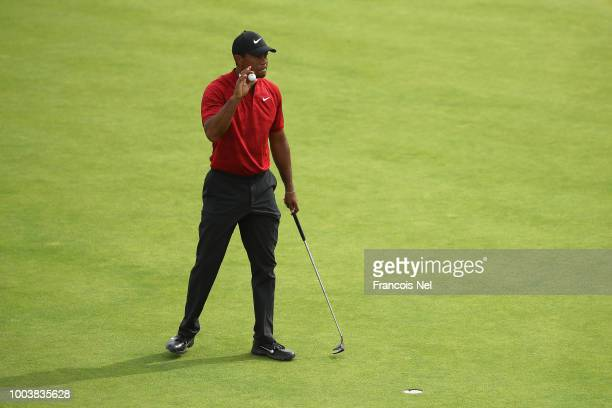 Tiger Woods of the United States reacts to a par putt on the eighth green during the final round of the 147th Open Championship at Carnoustie Golf...