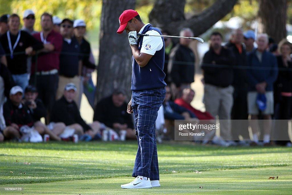 Tiger Woods of the United States reacts to a poor shot during the Afternoon Four-Ball Matches for The 39th Ryder Cup at Medinah Country Club on September 28, 2012 in Medinah, Illinois.