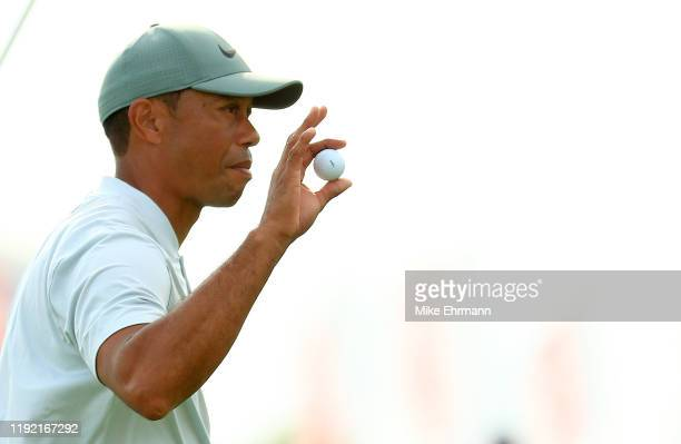 Tiger Woods of the United States reacts to a putt on the 18th hole during the second round of the Hero World Challenge at Albany on December 05, 2019...