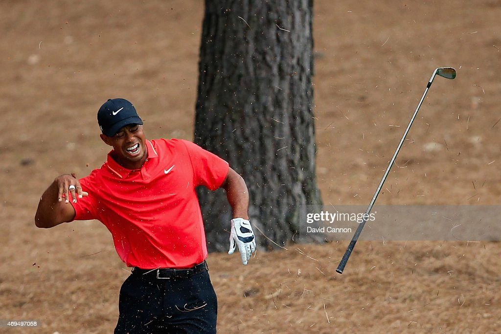 Tiger Woods of the United States reacts to a shot from the pine straw on the ninth hole during the final round of the 2015 Masters Tournament at Augusta National Golf Club on April 12, 2015 in Augusta, Georgia.